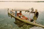 Gail Howard in Kashmir 1967. Gail Howard standing on a shikara floating taxi on Dal Lake en route to Shalimar Gardens.