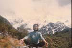 Gail Howard in New Zealand  1963. Gail Howard resting in a yoga posture after hiking up Mount Cook in New Zealand's South Island.