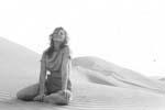 Gail Howard in Spanish Sahara 1962. Gail Howard on a mountainous sand dune in the Spanish Sahara.