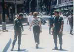 Gail Howard in Viet Nam 1967. G.I.'s glancing back at Gail Howard walking down Tudo Street in Saigon.